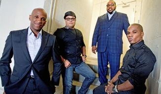 Singer Donnie McClurkin (far left) with gospel group the King's Men. (Associated Press)