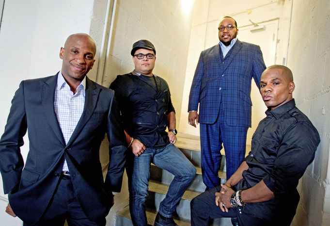 Singer Donnie McClurkin (far left) with gospel group the King's Men. (Associated Press)