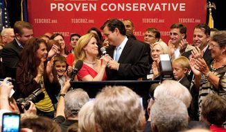 Ted Cruz thanks his wife, Heidi, in front of a cheering crowd after he defeated Republican rival, Lt. Gov. David Dewhurst, in a runoff election Tuesday for the GOP nomination for the U.S. Senate seat vacated by the retiring Kay Bailey Hutchison. (Houston Chronicle/Johnny Hanson via Associated Press)