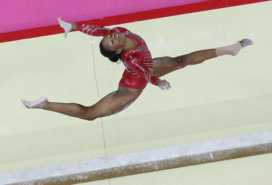 U.S. gymnast Gabby Douglas performs on the balance beam during the Artistic Gymnastic women's team final at the 2012 Summer Olympics, Tuesday, July 31, 2012, in London. (AP Photo/Julie Jacobson)