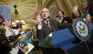Senate Majority Leader Harry Reid, Nevada Democrat, announces July 31, 2012, at the Capitol in Washingtonto reporters that he and GOP House Speaker John Boehner have reached an agreement to keep the government running on autopilot for six months when the current budget year ends on Sept. 30. (Associated Press)