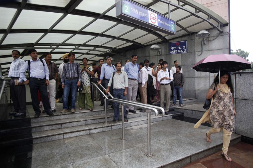 Indian commuters exit an underground metro station where services were fully restored after Tuesday's power outage in New Delhi, India, Wednesday, Aug. 1, 2012. (AP Photo/Rajesh Kumar Singh)