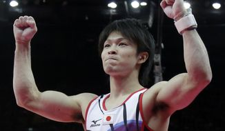 Japanese gymnast Kohei Uchimura gestures Aug. 1, 2012, after his performance on the pommel horse during the artistic gymnastics men's individual all-around competition at the 2012 Summer Olympics in London. (Associated Press)