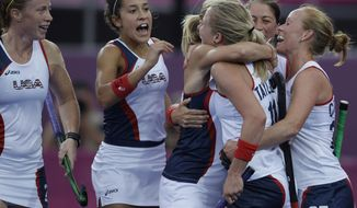 The United States' Shannon Taylor, second from right, is embraced by teammates after scoring the lone goal against Argentina during their women's hockey preliminary match at the 2012 Summer Olympics, Tuesday, July 31, 2012, in London. The U.S. won 1-0. (AP Photo/Bullit Marquez)