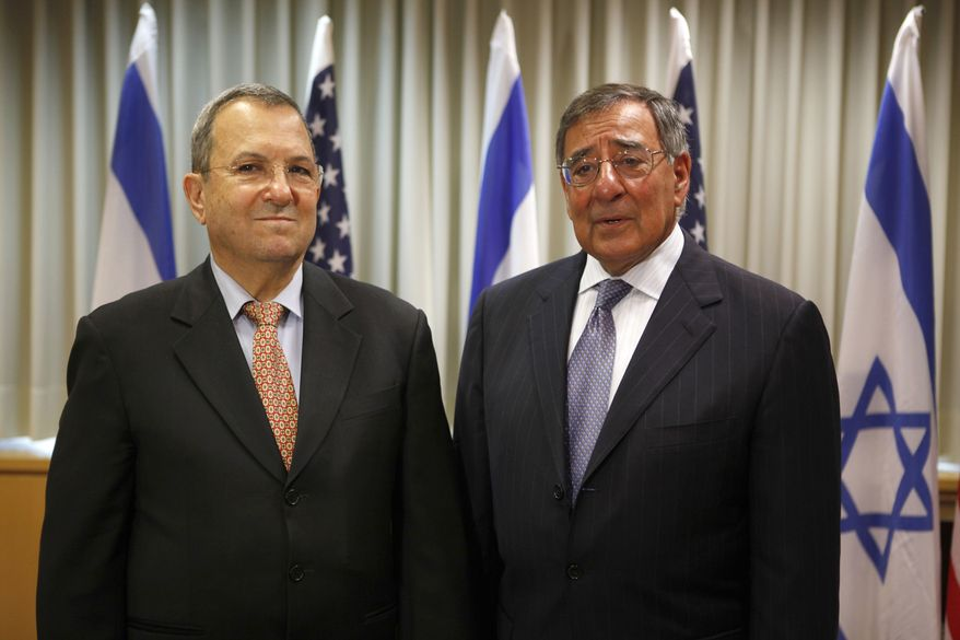 Israeli Defense minister Ehud Barak (left) and U.S. Defense Secretary Leon Panetta meet Aug. 1, 2012, in Tel Aviv. Israel's threats to attack Iran and the violence convulsing Syria top the agenda of Panetta's meetings Wednesday with Israeli government leaders. (Associated Press)