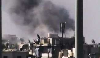 This image made from amateur video released by the Ugarit News and accessed July 31, 2012, purports to show black smoke rising from buildings in Aleppo, Syria. (Associated Press/Ugarit News via AP video)