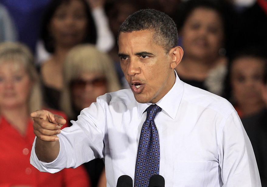 President Obama speaks on Wednesday, Aug. 1, 2012, at the John S. Knight Center in Akron, Ohio. (Associated Press)