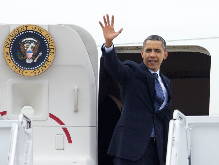President Barack Obama waves as he boards Air Force One at Andrews Air Force Base, Md., Wednesday, Aug. 1, 2012, for a campaign trip Ohio. (AP Photo/Manuel Balce Ceneta)