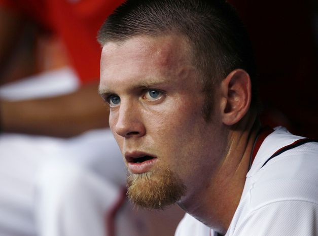Washington Nationals starting pitcher Stephen Strasburg sits in the dugout in the first inning of a a baseball game against the Philadelphia Phillies, Tuesday, July 31, 2012, in Washington. The Phillies won 8-0. (AP Photo/Carolyn Kaster)