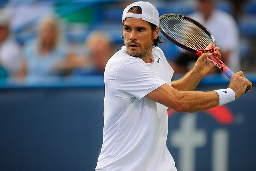 Tommy Haas hits a shot July 31, 2012, during his match against Michael Russell in the Citi Open tennis tournament at the William H.G. FitzGerald Tennis Center in Washington, D.C. (Ryan M.L. Young/The Washington Times)