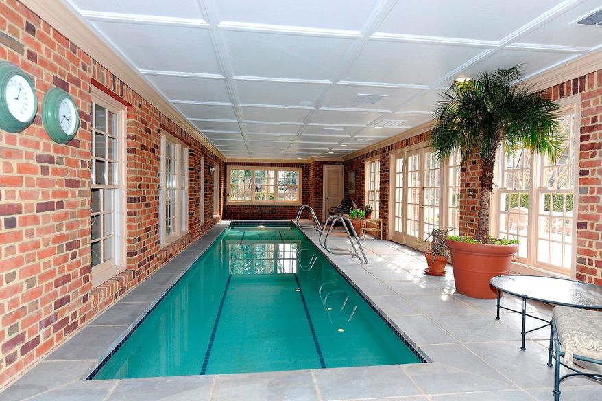 The enclosed patio holds a 10-by-40-foot lap pool with a retractable cover that can be used year-round.