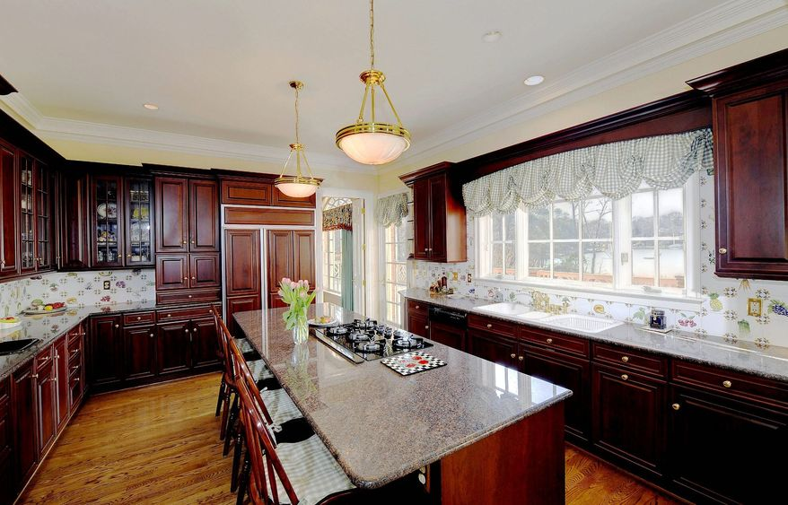 The custom-designed kitchen features cherry cabinets.