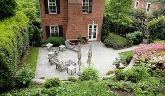 The home at 3028 New Mexico Ave. NW in the District is on the market for $1,095,000. The three-bedroom home has three full baths and a powder room. Outside, a laurel hedge and wrought-iron fencing enclose the back and sides of the property, lending privacy to the flagstone patio with its outdoor fireplace.