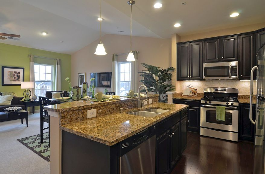 The one-level Rubens model features granite counters in the kitchen.