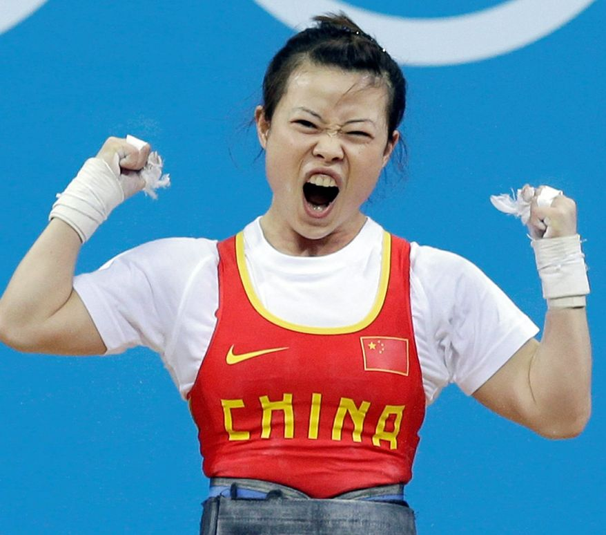 Chinese weight-lifting gold medalist Wang Mingjuan rejoices in victory. (Associated Press)