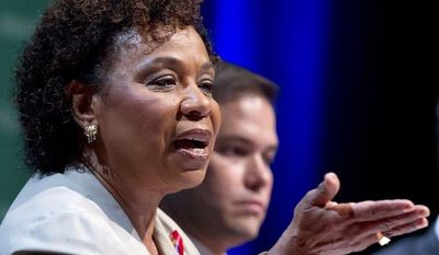"Rep. Barbara Lee, D-Calif., accompanied by Sen. Marco Rubio, R-Fla., speaks during a session entitled: 'The U.S. Congress and the Global AIDS Epidemic"" Wednesday, July 25, 2012, at the XIX International AIDS Conference in Washington. (AP Photo/Carolyn Kaster)"