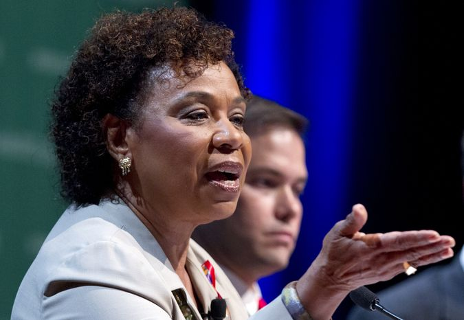 """** FILE ** Rep. Barbara Lee, D-Calif., accompanied by Sen. Marco Rubio, R-Fla., speaks during a session titled: 'The U.S. Congress and the Global AIDS Epidemic"""" Wednesday, July 25, 2012, at the XIX International AIDS Conference in Washington. (AP Photo/Carolyn Kaster)"""