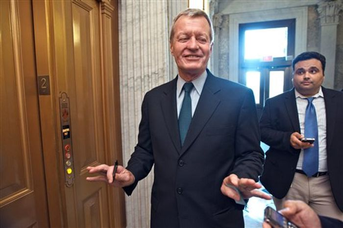 Sen. Max Baucus, Montana Democrat, chairman of the Senate Finance Committee pauses following final votes as the Senate leaves for a five-week recess, on Capitol Hill in Washington, Thursday, Aug. 2, 2012. (Associated Press)