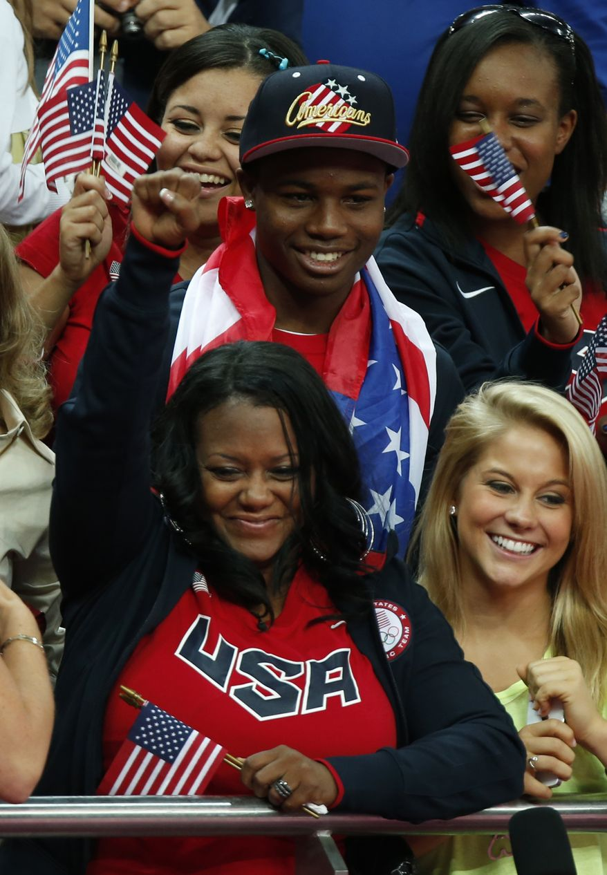 Natalie Hawkins, bottom left, mother of U.S. gymnast Gabrielle Douglas, cheers for her gold medallist daughter during the artistic gymnastics women's individual all-around competition at the 2012 Summer Olympics, Thursday, Aug. 2, 2012, in London. (AP Photo/Matt Dunham)