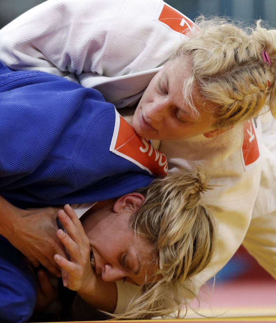 Kayla Harrison of the United States (in white) competes Aug. 2, 2012, against Gemma Gibbons of Great Britain for the gold medal during the women's 78-kg judo competition at the 2012 Summer Olympics in London. (Associated Press)