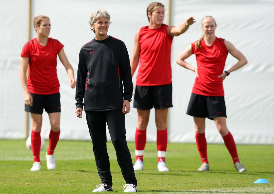 United States head coach Pia Sundhage of Sweden, center, trains with her players during soccer practice for the 2012 London Summer Olympics at Cochrane Park in Newcastle, England, on Thursday, Aug. 2, 2012. The United States will face New Zealand in the women's quarter final soccer match on Friday. (AP Photo/Scott Heppell)