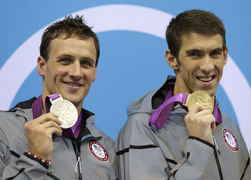 United States' Michael Phelps, right, and United States' Ryan Lochte pose with their medals for the men's 200-meter individual medley swimming final at the Aquatics Centre in the Olympic Park during the 2012 Summer Olympics in London, Thursday, Aug. 2, 2012. Phelps won gold and Lochte silver. (AP Photo/Michael Sohn)
