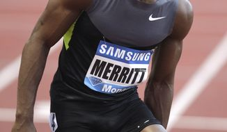 Lashawn Merritt of USA reacts after to be injured in the 400m men race at the Herculis International Athletics Meeting, at the Louis II Stadium in Monaco, Friday, July 20, 2012. (AP Photo/Lionel Cironneau)