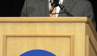 Ed Ray, NCAA Executive Committee chair and Oregon State University president answers questions about the  penalties against Penn State during a news conference in Indianapolis, Monday, July 23, 2012. The NCAA has slammed Penn State with an unprecedented series of penalties, including a $60 million fine and the loss of all coach Joe Paterno's victories from 1998-2011, in the wake of the Jerry Sandusky child sex abuse scandal. (AP Photo/Michael Conroy)