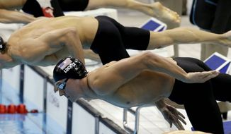 United States Michael Phelps, left, and Ryan Lochte start the men's 200-meter individual medley swimming semifinal at the Aquatics Centre in the Olympic Park during the 2012 Summer Olympics in London, Wednesday, Aug. 1, 2012. (AP Photo/Lee Jin-man)