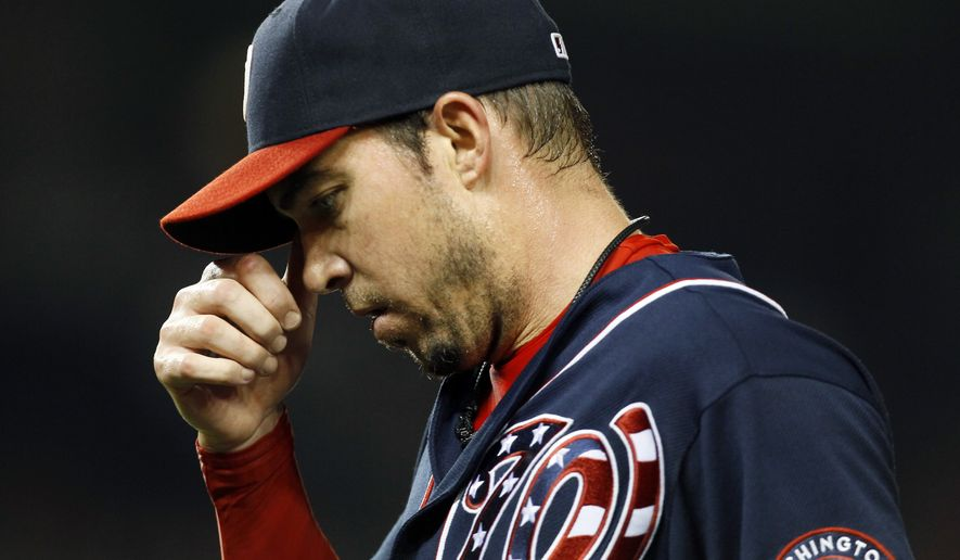 Washington Nationals relief pitcher Sean Burnett walks off the field in the ninth inning of a baseball game against the Philadelphia Phillies, Wednesday, Aug. 1, 2012, in Washington. The Phillies won 3-2. (AP Photo/Carolyn Kaster)