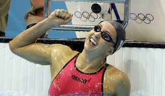 United States' Rebecca Soni celebrates her gold medal finish in the women's 200-meter breaststroke swimming final at the Aquatics Centre in the Olympic Park during the 2012 Summer Olympics in London, Thursday, Aug. 2, 2012. (AP Photo/Matt Slocum)