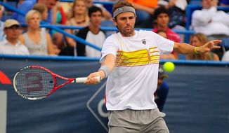 Mardy Fish plays in his match against Ricardas Berankis at the Citi Open tennis tournament at the William H.G. FitzGerald Tennis Center, Washington D.C., Thursday, August 2, 2012.  (Ryan M.L. Young/The Washington Times)