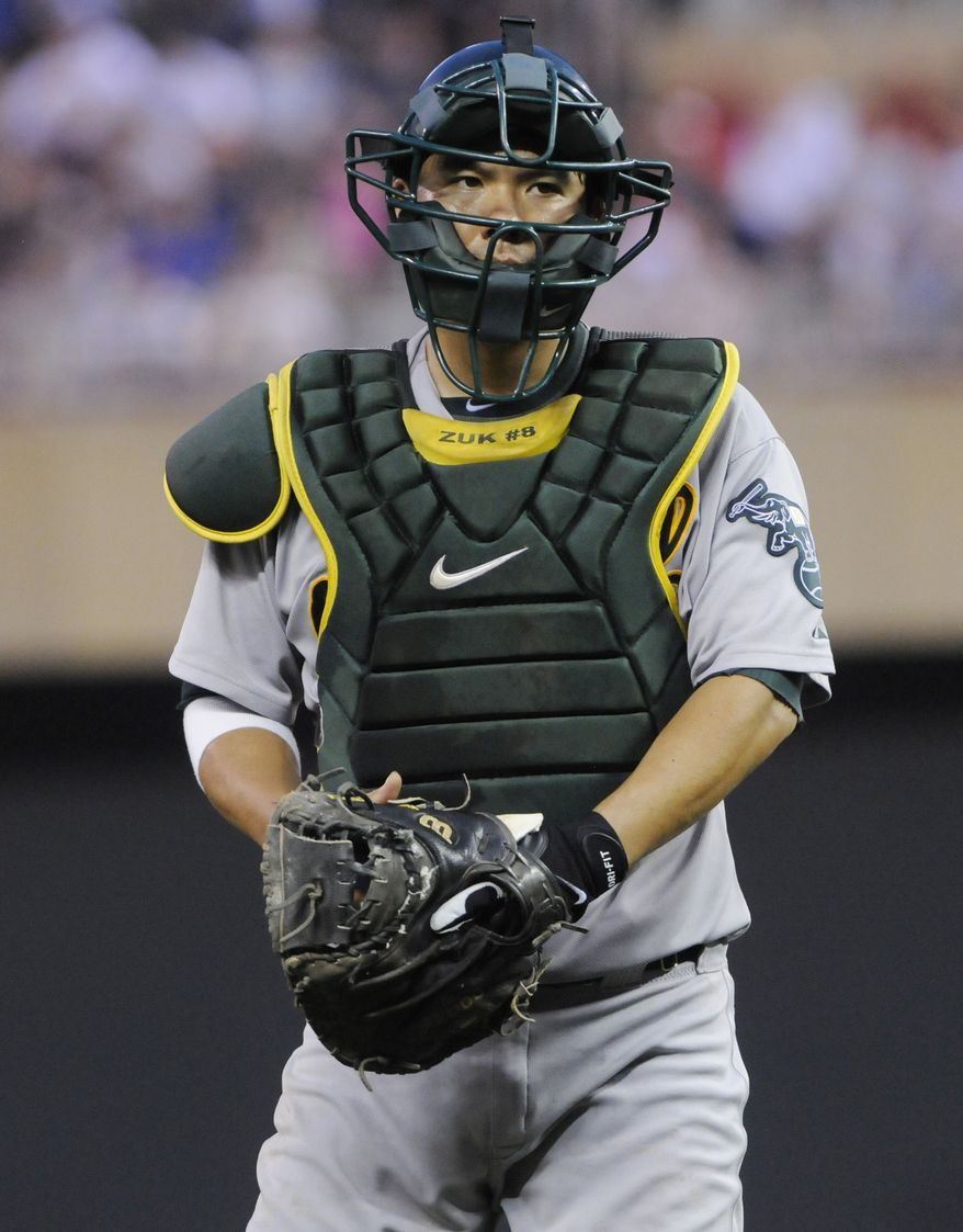 The Washington Nationals traded for Oakland A's catcher Kurt Suzuki on Friday afternoon, adding a veteran piece to their catching corps. (AP Photo/Jim Mone)