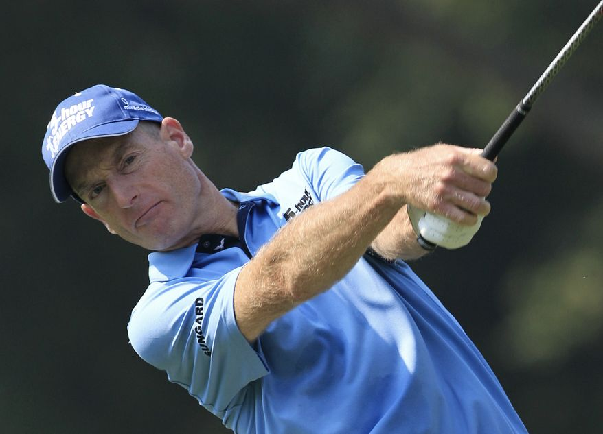 Jim Furyk tees off on the third hole during the second round of the Bridgestone Invitational golf tournament at Firestone Country Club, Friday, Aug. 3, 2012, in Akron, Ohio. (AP Photo/Tony Dejak)