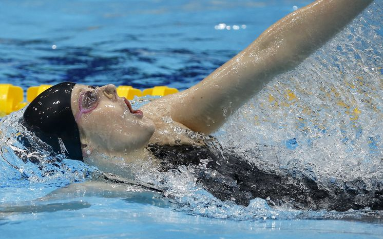 United States' Missy Franklin competes in the women's 200-meter backstroke swimming semifinal at the Aquatics Centre in the Olympic Park during the 2012 Summer Olympics in London, Thursday, Aug. 2, 2012. (AP Photo/Daniel Ochoa De Olza)