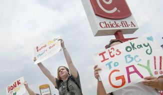 Gay marriage supporters, from left, Emmie Hesley, Cathy Dear and Amy Paffenroth hold signs in front of a Chick-fil-A in Fort Walton Beach, Fla., Thursday Aug. 2, 2012, in protest of the chicken eatery's stance on gay marriage. (AP Photo/Northwest Florida Daily News, Nick Tomecek) **FILE**