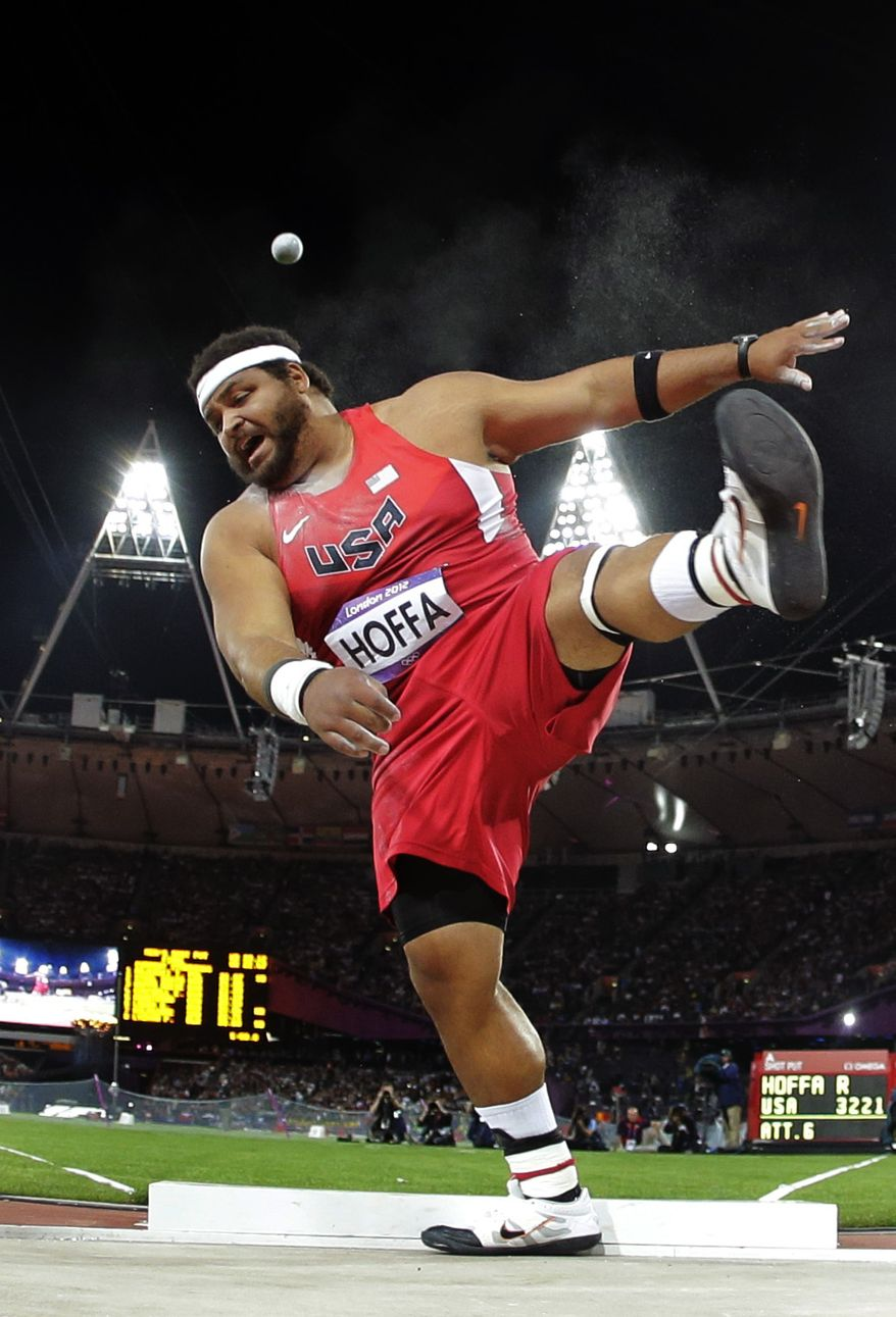 United States' Reese Hoffa competes in the men's shot put final during the athletics competition in the Olympic Stadium at the 2012 Summer Olympics, Friday, Aug. 3, 2012, in London. (AP Photo/David J. Phillip)
