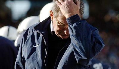 FILE - In this Nov. 6, 2004, file photo, Penn State coach Joe Paterno pauses on the sidelines during the fourth quarter of his team's 14-7 loss to Northwestern in State College, Pa. The NCAA has slammed Penn State with an unprecedented series of penalties, including a $60 million fine and the loss of all coach Joe Paterno's victories from 1998-2011, in the wake of the Jerry Sandusky child sex abuse scandal.   (AP Photo/Carolyn Kaster,file)