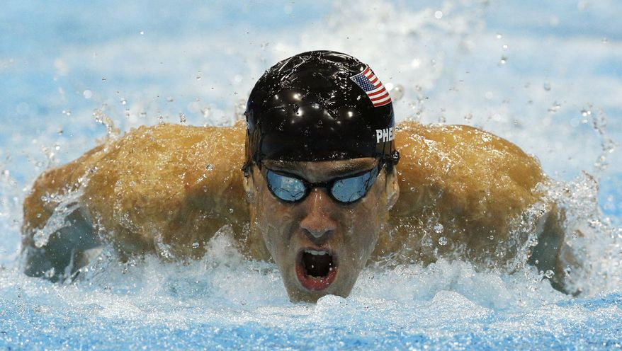 United States' Michael Phelps competes in a men's 100-meter butterfly swimming semifinal at the Aquatics Centre in the Olympic Park during the 2012 Summer Olympics in London, Thursday, Aug. 2, 2012. (AP Photo/Michael Sohn)
