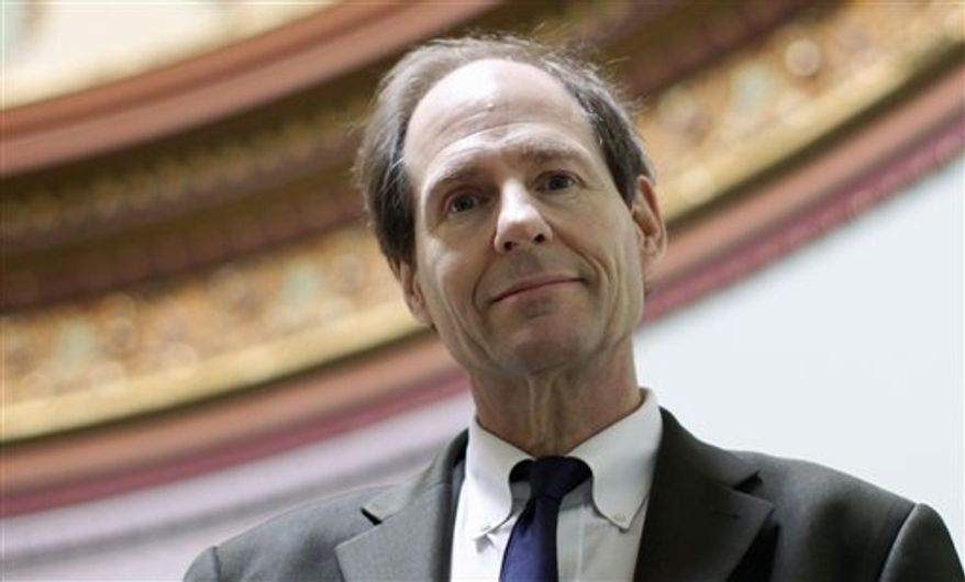 ** FILE ** In this file photo taken on March 16, 2011, Cass Sunstein, director of the Office of Information and Regulatory Affairs at the Office of Management and Budget, poses for a photo at the Eisenhower Executive Office Building across from the White House in Washington. (AP Photo)