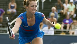 Anastasia Pavlyuchenkova, of Russia, hits a return against Vania King during the Citi Open tennis tournament on Friday, Aug. 3, 2012, in Washington.  (AP Photo/Evan Vucci)