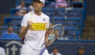 Sam Querrey reacts after defeating Kevin Anderson, of South Africa, during the Citi Open tennis tournament on Friday, Aug. 3, 2012, in Washington. (AP Photo/Evan Vucci)