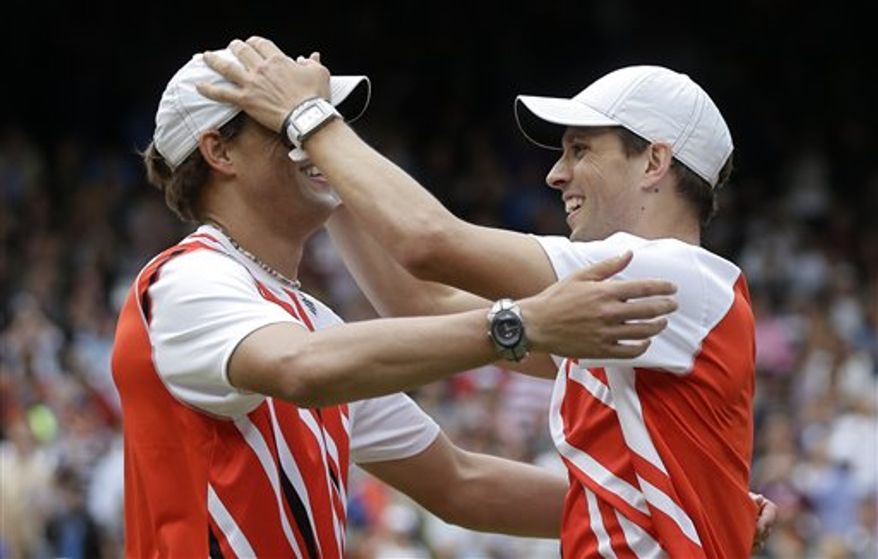 Mike Bryan, right, and Bob Bryan, left, of the United States, celebrate after defeating Jo-Wilfried Tsonga and Michael Llodra of France in the men's doubles gold medal match at the All England Lawn Tennis Club at Wimbledon, in London, at the 2012 Summer Olympics, Saturday, Aug. 4, 2012. (AP Photo/Victor R. Caivano)
