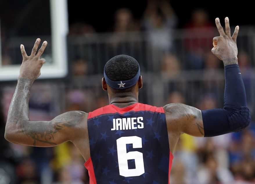 USA's Lebron James (6) signals after scoring with a three point basket during a preliminary men's basketball game against Lithuania at the 2012 Summer Olympics, Saturday, Aug. 4, 2012, in London. (AP Photo/Eric Gay)