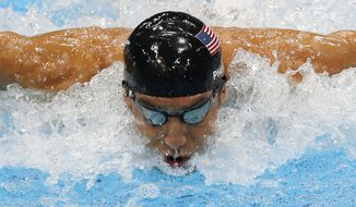 ** FILE ** United States' Michael Phelps swims in the men's 4 X 100-meter medley relay at the Aquatics Centre in the Olympic Park during the 2012 Summer Olympics in London, Saturday, Aug. 4, 2012. (AP Photo/Julio Cortez)