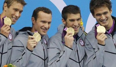 United States' men's 4 X 100-meter medley relay team from left, Matthew Grevers, Brendan Hansen, Michael Phelps and Nathan Adrian hold their gold medals at the Aquatics Centre in the Olympic Park during the 2012 Summer Olympics in London, Saturday, Aug. 4, 2012. (AP Photo/Jae C. Hong)