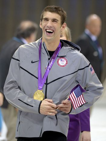United States' swimmer Michael Phelps smiles as he wars his 1th gold medal at the Aquatics Centre in the Olympic Park during the 2012 Summer Olympics in London, Saturday, Aug. 4, 2012. Phelps pushed the United States in front to win the medley relay Saturday in the final swimming event of the London Games, after which he is retiring.(AP Photo/Mark J. Terrill)
