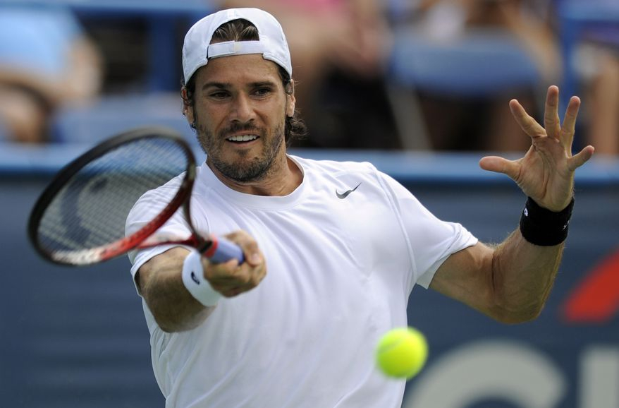 Tommy Haas, of Germany, returns the ball against Mardy Fish during a semifinal in the Citi Open tennis tournament on Saturday, Aug. 4, 2012, in Washington. (AP Photo/Nick Wass)
