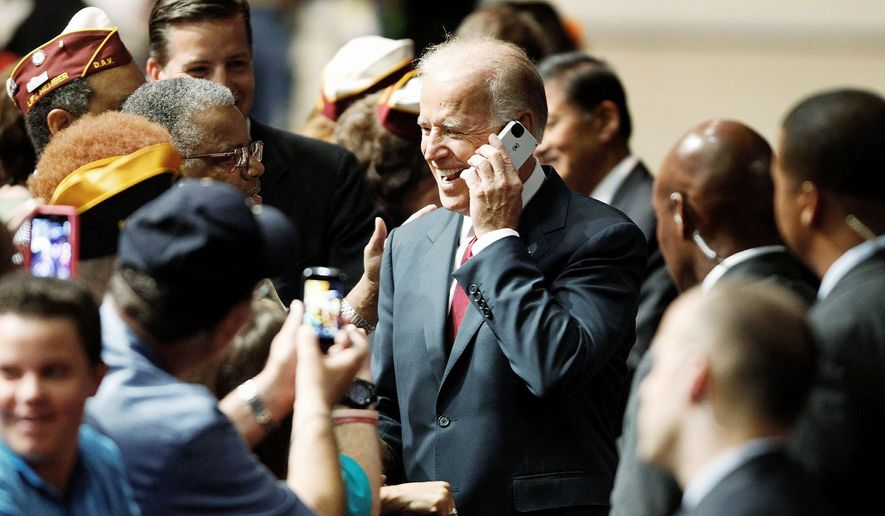Vice President Joseph R. Biden speaks in Las Vegas on Saturday on an audience member's cellphone at the national convention of the Disabled American Veterans, which he addressed on behalf of the campaign. (Associated Press)