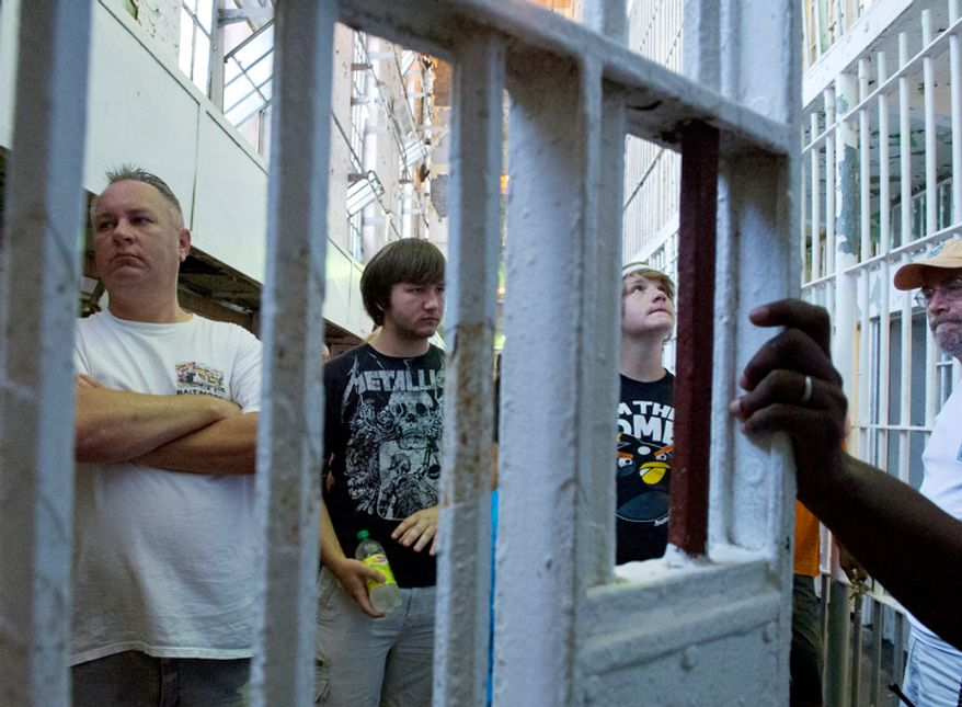 "A tour group waits for the ""all clear"" to move out of the cell block corridor to the next part of the tour at the Maryland House of Corrections in Jessup, Md., during an open house on Sunday, Aug. 5, 2012.  (Barbara L. Salisbury/The Washington Times)"
